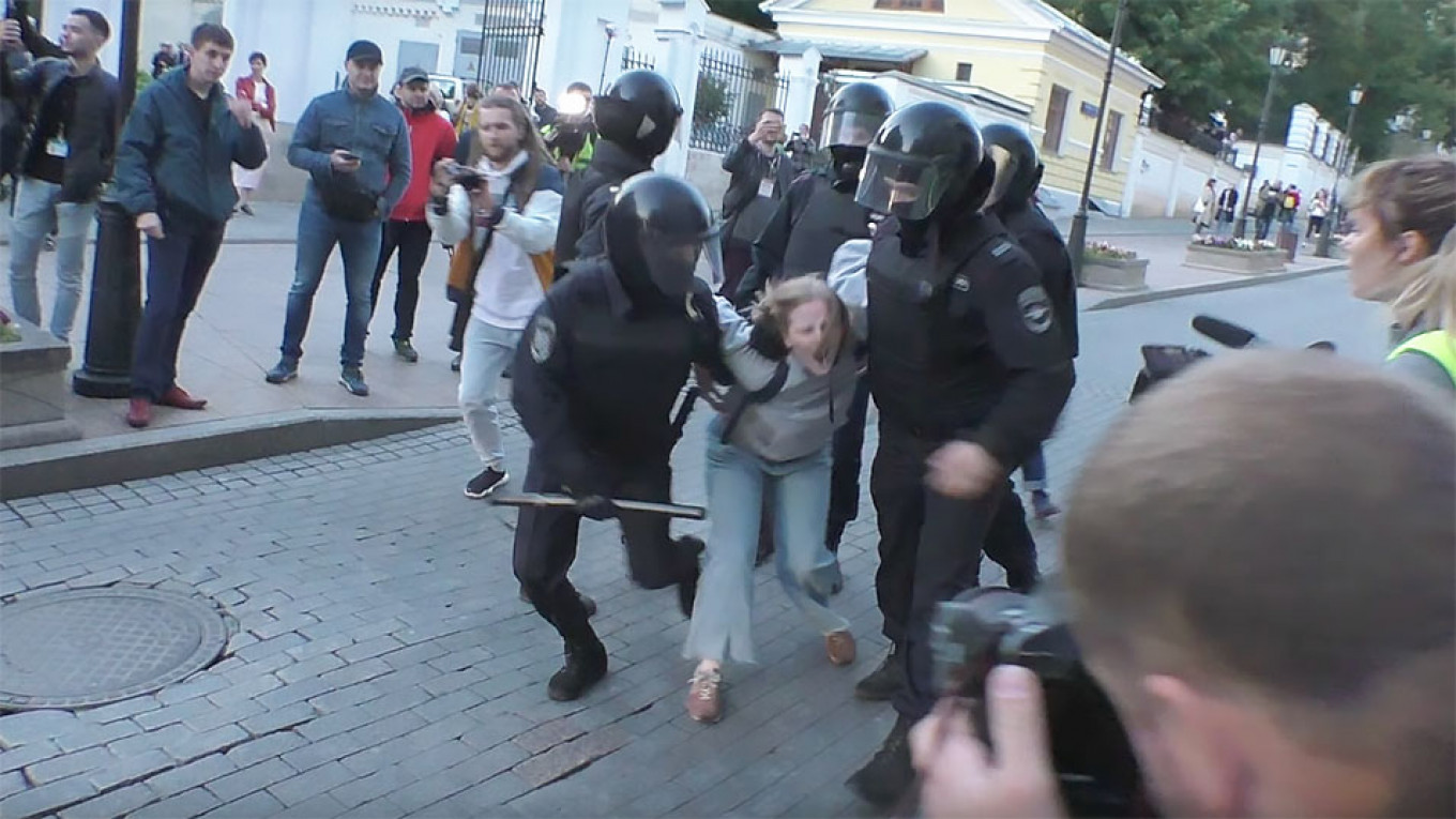 Viral Clip of Russian Policeman Punching Young Woman During Protests Stirs Anger