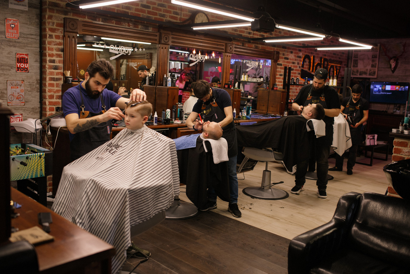 Dmitri Porochkin, an entrepreneur who owns four Old Boy barbershop franchises, says business is down around one-quarter already. He also runs two coffee shops, where trade is down 50%. He wants the government to set up a fund to help small business owners make rent payments. Credit: . Dmitri Porochkin