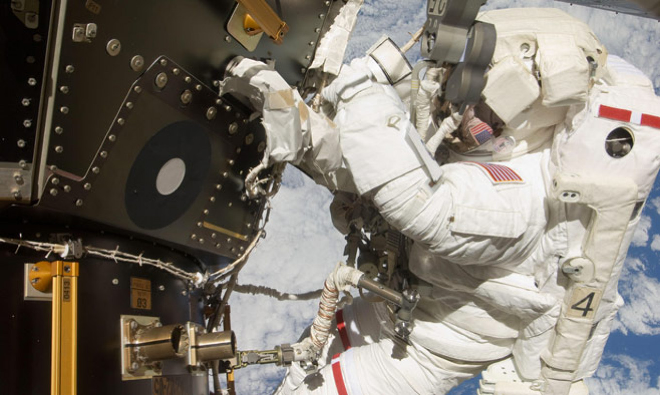 NASA astronaut Mike Hopkins conducting the second of two spacewalks over a four day period in December 2013. NASA