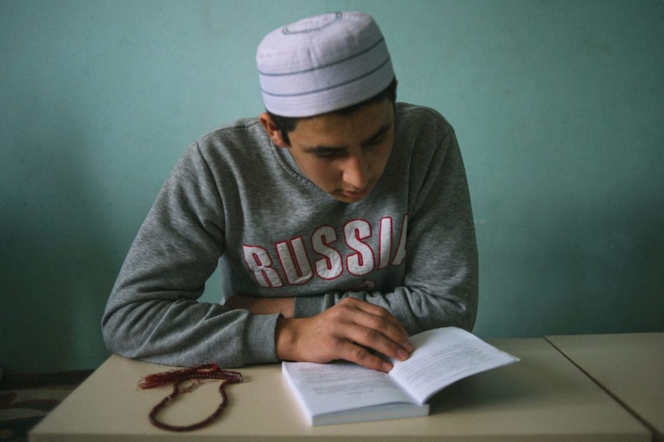 A student at the Volga Islamic Center reads from the Qoran Sergey Karpov for TD