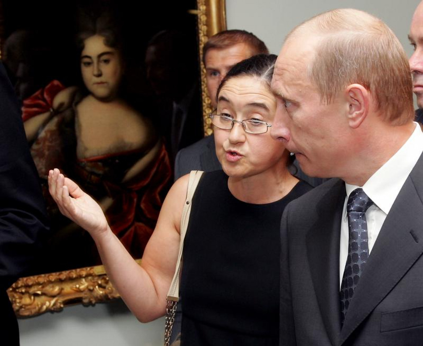 """Russian President Vladimir Putin (R) takes a tour of """"Russia!"""" with Zelfira Tregulova at the Guggenheim Museum in New York, Sept. 14, 2005.  Jeff Zelevansky / Reuters"""