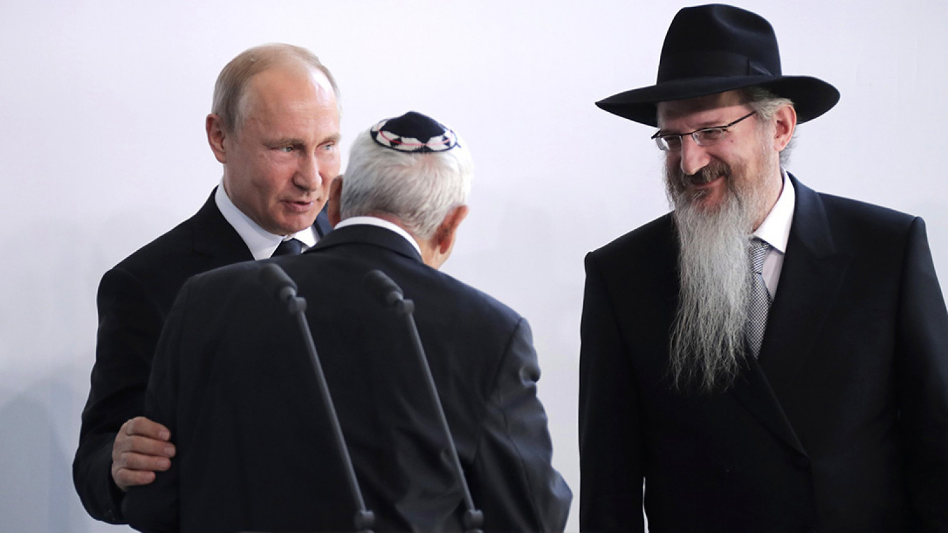 Putin, with Russia's chief rabbi Berel Lazar, right, has fashioned himself as a backer of Russia's Jewish community				 				Mikhail Metsel / TASS