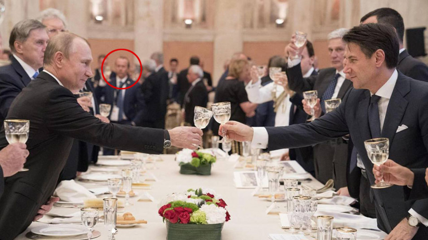Savoini (circled) is seen in the background at the government dinner for Putin hosted by Italian Prime Minister Giuseppe Conte.				 				Presidency of the Council of Ministers