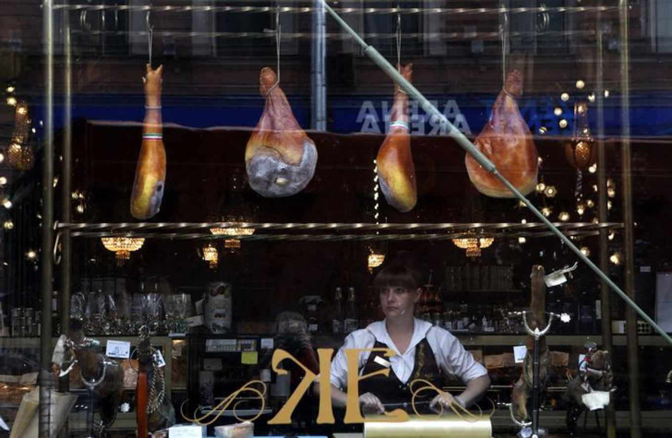Spanish ham is displayed for sale in a shop window at a grocery store in St. Petersburg. Russia stopped imports of most food from the West. Alexander Demianchuk / Reuters