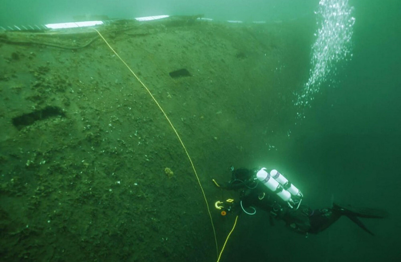 A diver examines the hull of the dumped nuclear powered submarine K-27 in the Kara Sea. Center for Underwater Research of the Russian Geographical Society