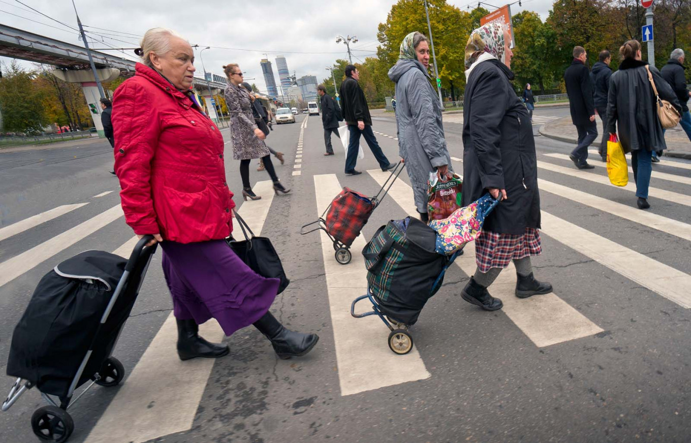 A group of women crossing the street at the All-Russia Exhibition Center, where many of them sell food and clothing. 				 				Vladimir Filonov / MT