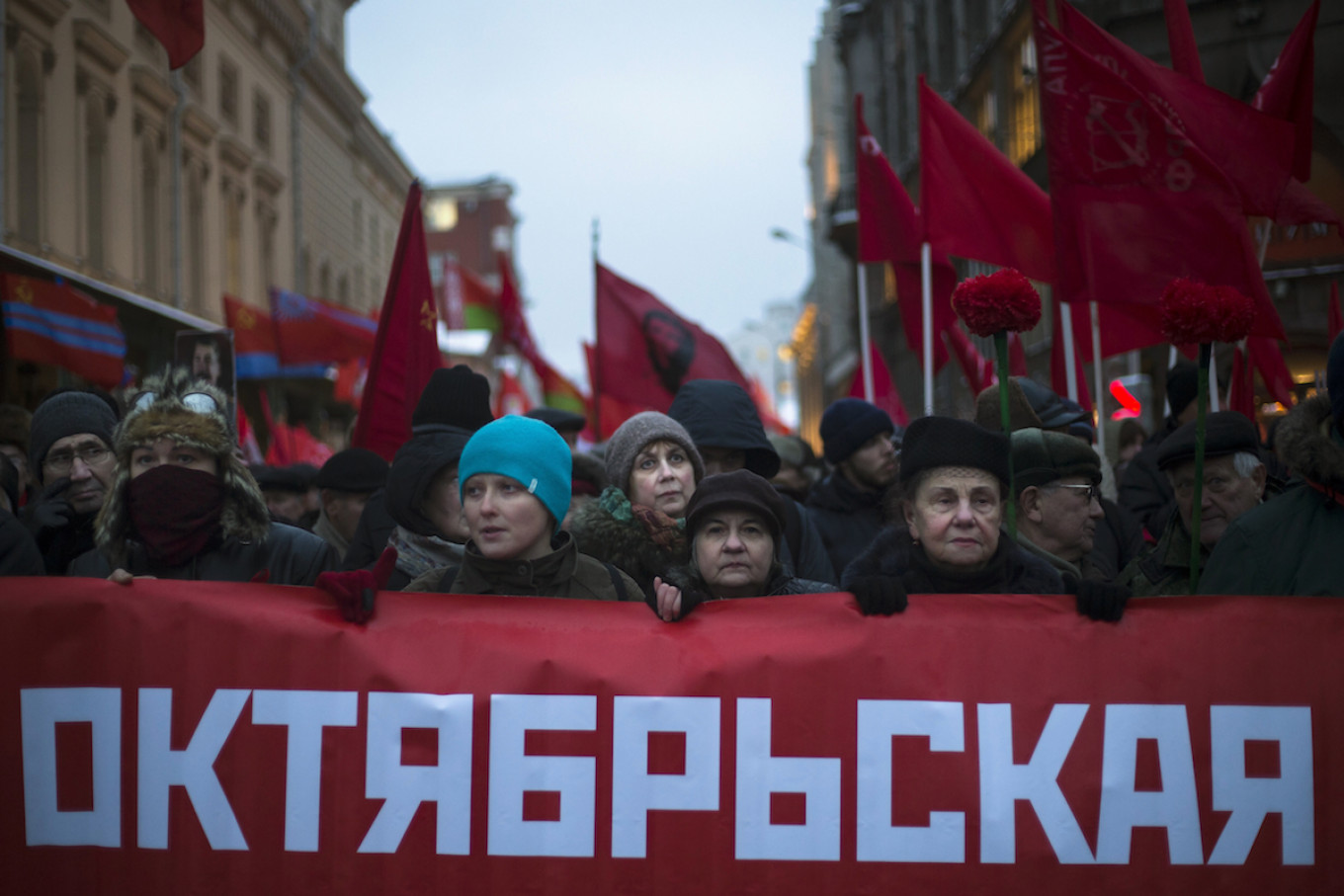Communist party supporters carry a banner that reads 'the Great October's Socialistic Revolution' during a rally  AP Photo/Alexander Zemlianichenko