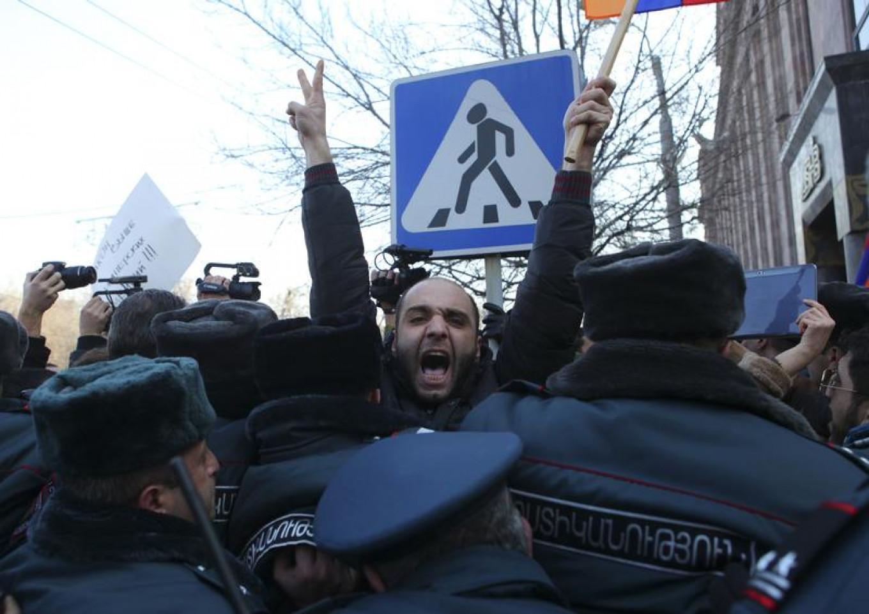 Policemen block protesters near the Russian embassy in Yerevan, Jan. 15, 2015.  Hrant Khachatryan / Reuters