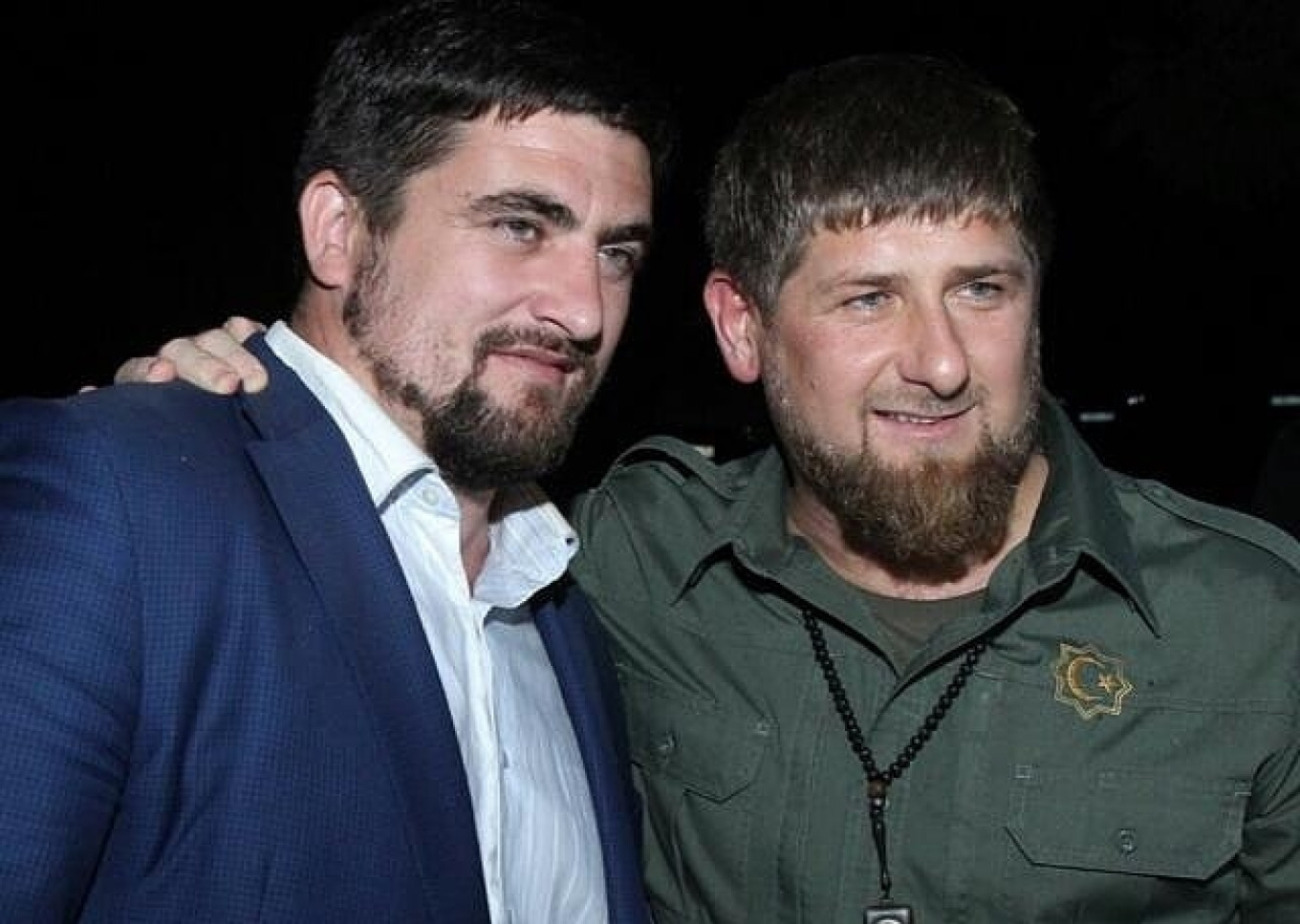 "Beslan Terekbayev (on the left) says that with Kadyrov's help they ""will seize the world.""				 				ChechenFilm"