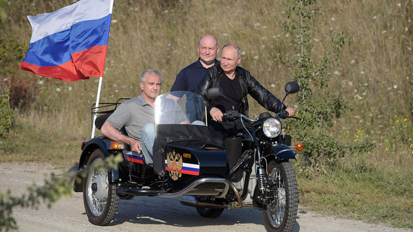 Putin Sued Over Helmet-Free Motorcycle Ride in Crimea - The Moscow Times