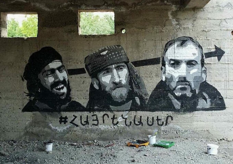 Graffiti in the Armenian capital of Yerevan shows three of the Sassoun Daredevil gunmen, with the word 'Patriot' written below. Robert Nikoghosyan Art