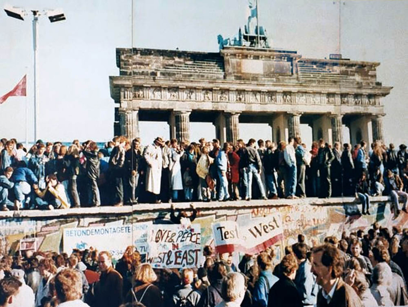 West and East Germans at the Brandenburg Gate in 1989				 				Wikicommons