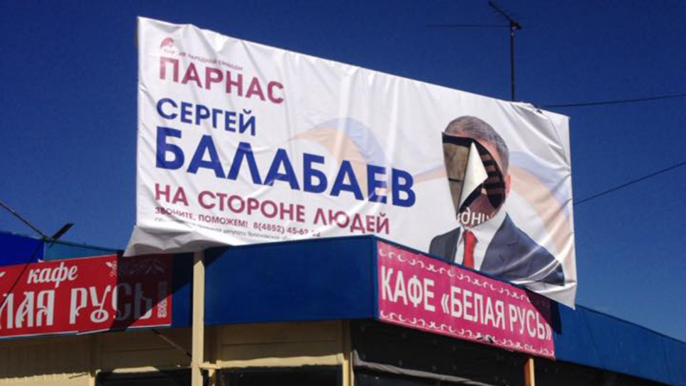 Spoiled election poster