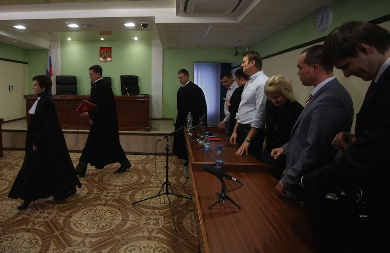 Alexei Navalny watches as judges leave a court room at the end of a hearing at a Kirov court in Kirov, Russia, Oct. 16, 2013. Evgeny Feldman / AP