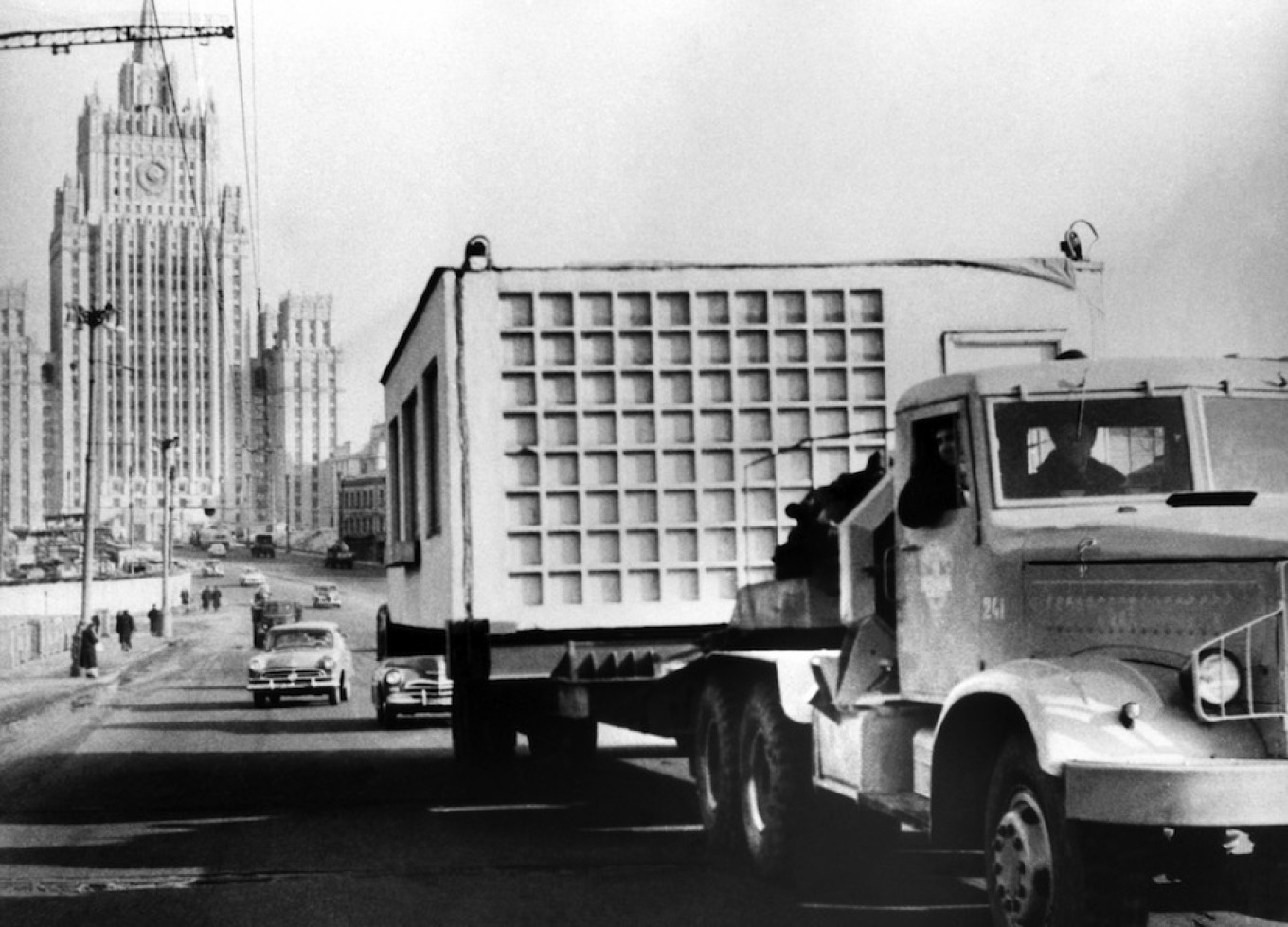 A truck transports parts of a Khrushchevka during a massive housing building boom in 1960, Moscow, Soviet Union.				 				TASS