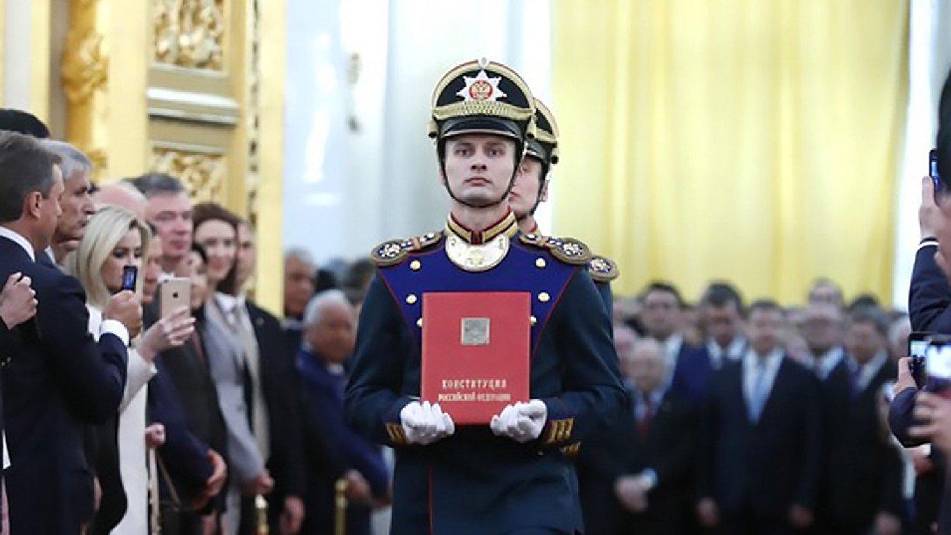 Guards carry the Constitution ahead of Vladimir Putin's inauguration for a fourth term in May 2018.  Kremlin.ru