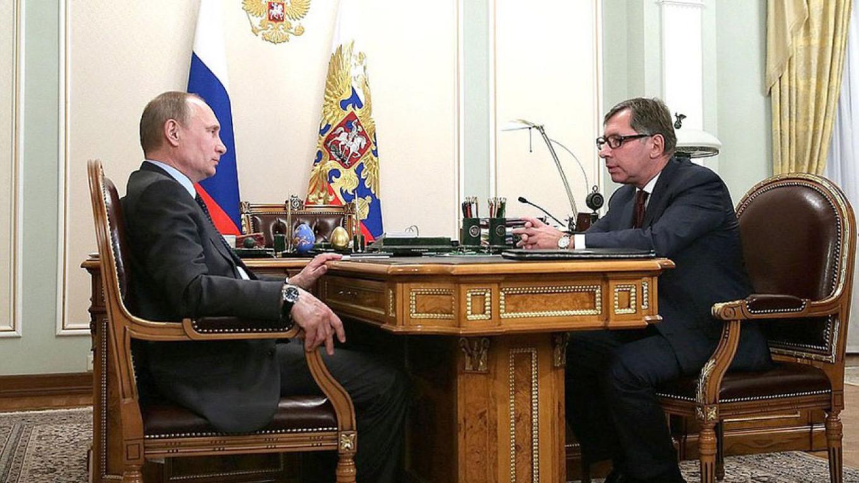 A past meeting between President Vladimir Putin and Pyotr Aven in February 2014. Kremlin.ru