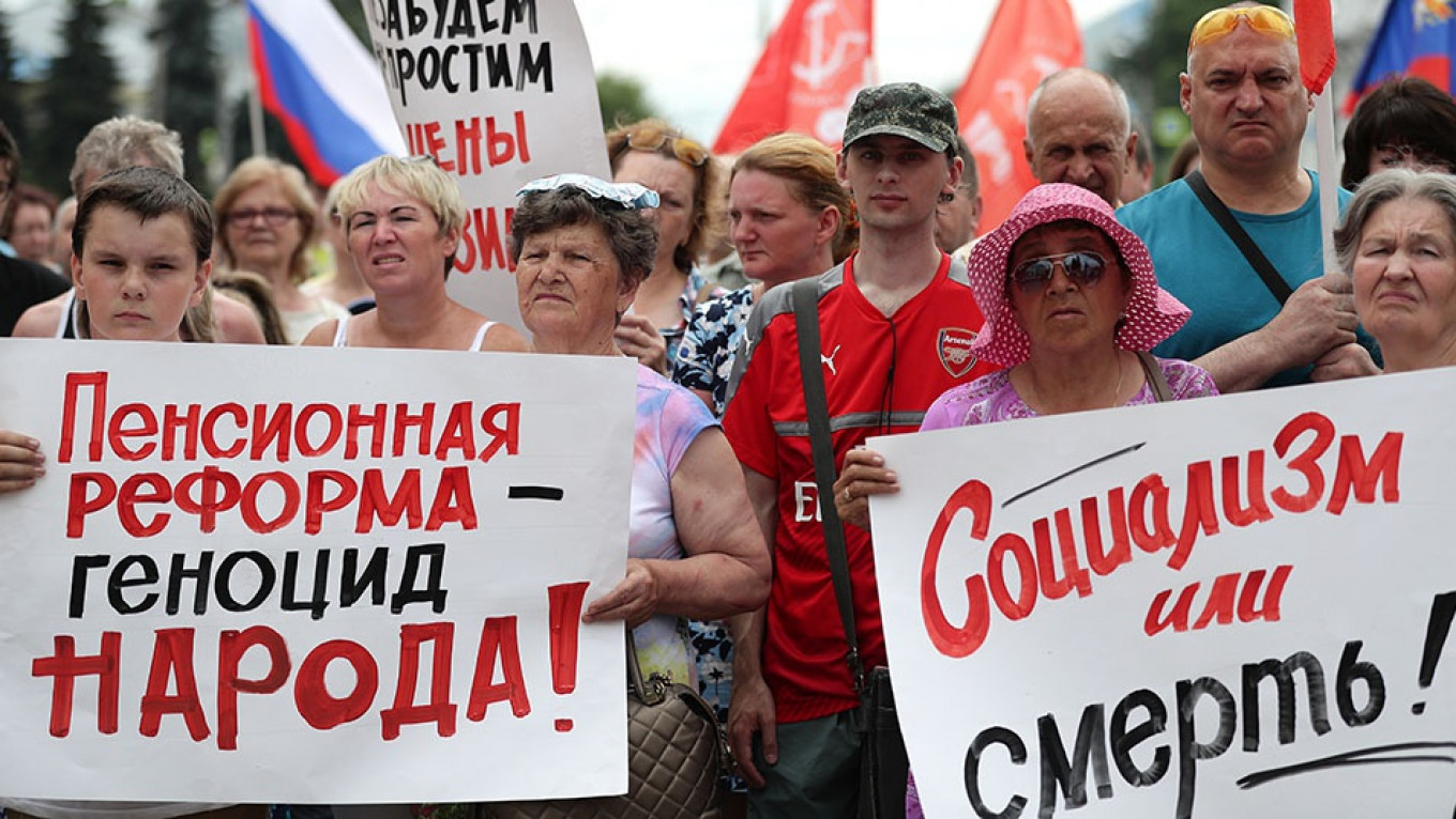 Putin's popularity ratings dipped sharply this summer after the governent raised Russians' retirement age. Vladimir Smirnov / TASS