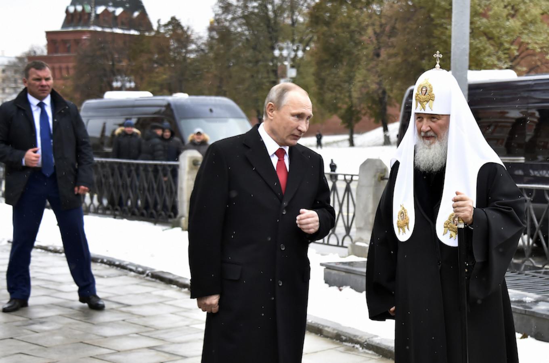Russian President Vladimir Putin and Russian Orthodox Patriarch Kirill speak in Red Square in Moscow, Russia. Alexander Nemenov / AP