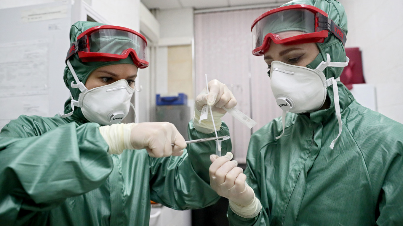 Coronavirus Could Rock Russia's 'Stable and Isolated' Economy - The Moscow Times