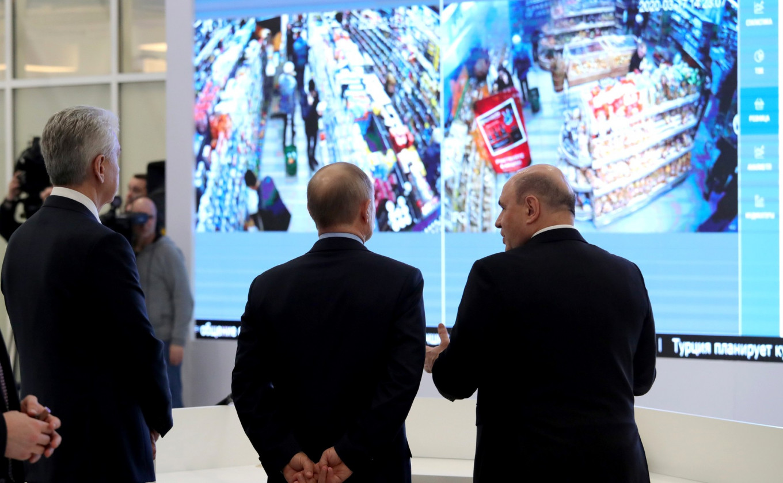 President Vladimir Putin, Prime Minister Mikhail Mishustin and Moscow Mayor Sergei Sobyanin inspect video footage of full supermarket shelves. Kremlin.ru