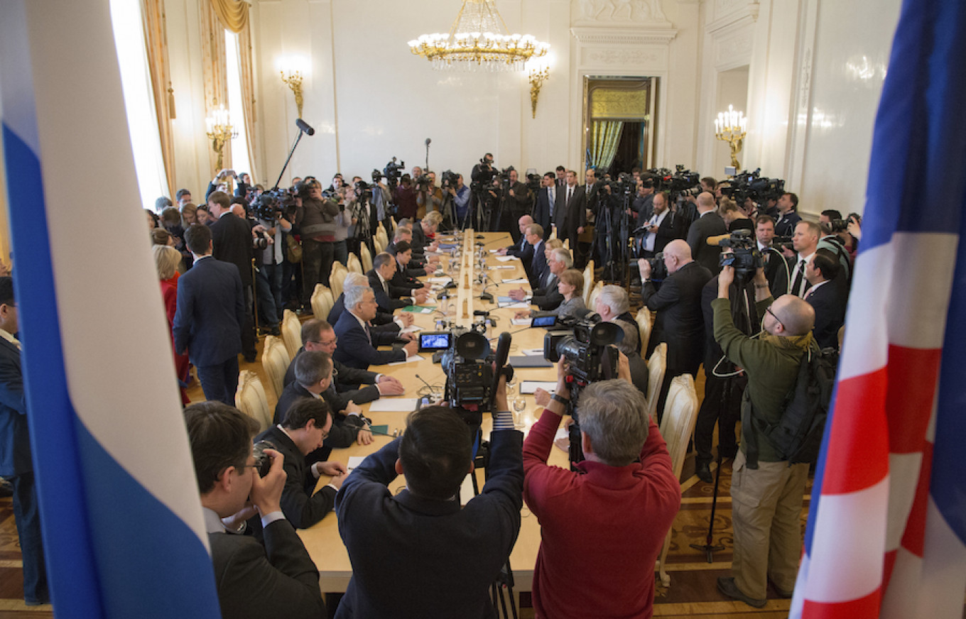 Media surround a table as U.S. Secretary of State Rex Tillerson and Russian Foreign Minister Sergei Lavrov talk in Moscow, Russia, April 12, 2017. Ivan Sekretarev / AP