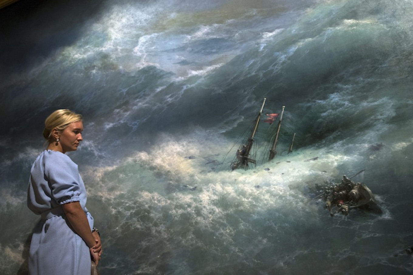 """A woman looks at the """"Wave"""" painting by Ivan Aivazovsky in Tretyakov Gallery, Moscow, Russia. Pavel Golovkin / AP"""