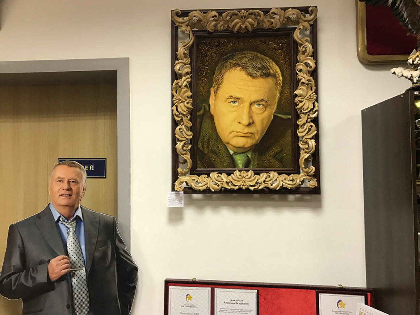 A cardboard cutout and portrait of Zhirinovsky at his campaign headquarters				 				Evan Gershkovich