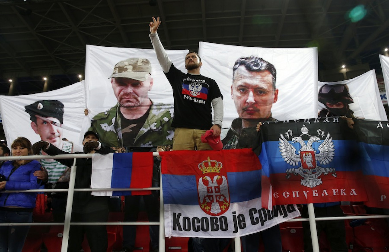 Ukrainian separatist flags appear at a EURO 2016 qualifier. Fans have long harbored links with nationalist causes. Maxim Zmeyev / Reuters