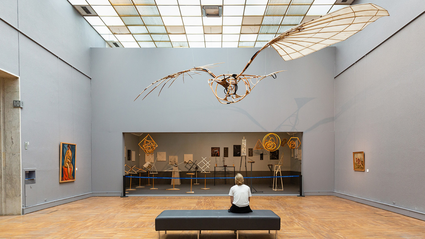 "Vladimir Tatlin's ""Letatlin"" flying machine (1932) soaring above a reconstruction of the Society of Young Artist's constructivist exhibit of 1921.				 				Courtesy of the State Tretyakov Gallery"