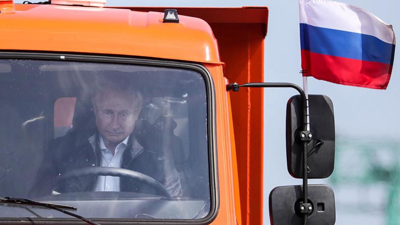 Putin drives a truck across the Crimean bridge during its unveiling. Sergei Bobylev / TASS