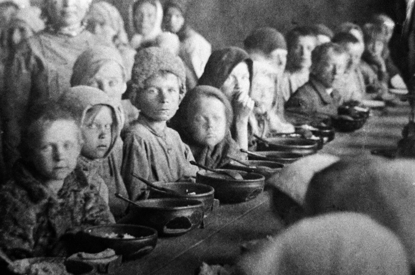 Children eat in a canteen for victims of starvation. Pokrovsk, Saratov province, 1922.  TASS