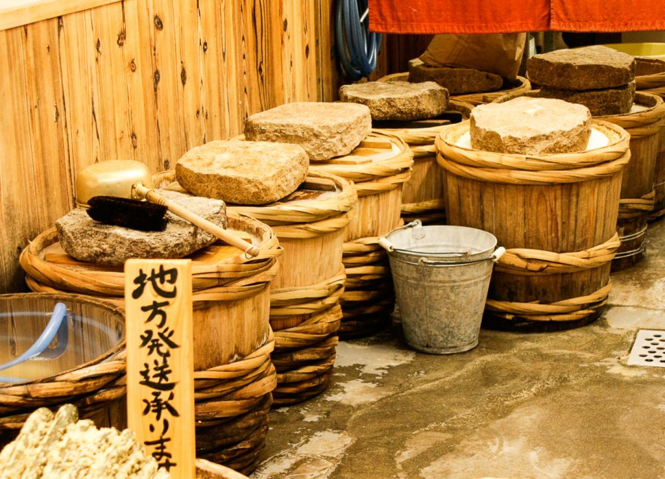 Fermenting vessels with weights at Kyoto Market.				 				Jennifer Eremeeva / MT