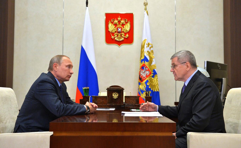 Russian President Vladimir Putin listens to Yury Chaika in the Kremlin in Moscow, Russia. Kremlin Press Service