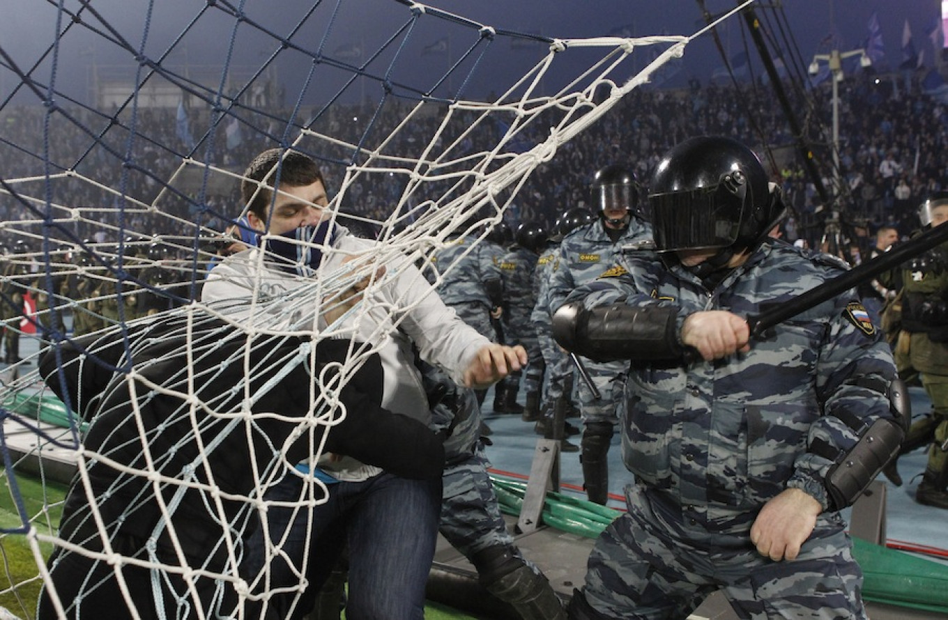 Zenit St. Petersburg fans clash with riot police. Zenit's fans are considered to be among the most violent in Russia. Maxim Shemetov / Reuters
