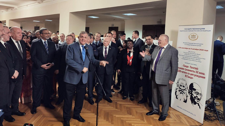Nikolai Kolomeitsev speaks while Indian Ambassador Varma looks on behind him to the left.  Loretta Marie Perera / MT