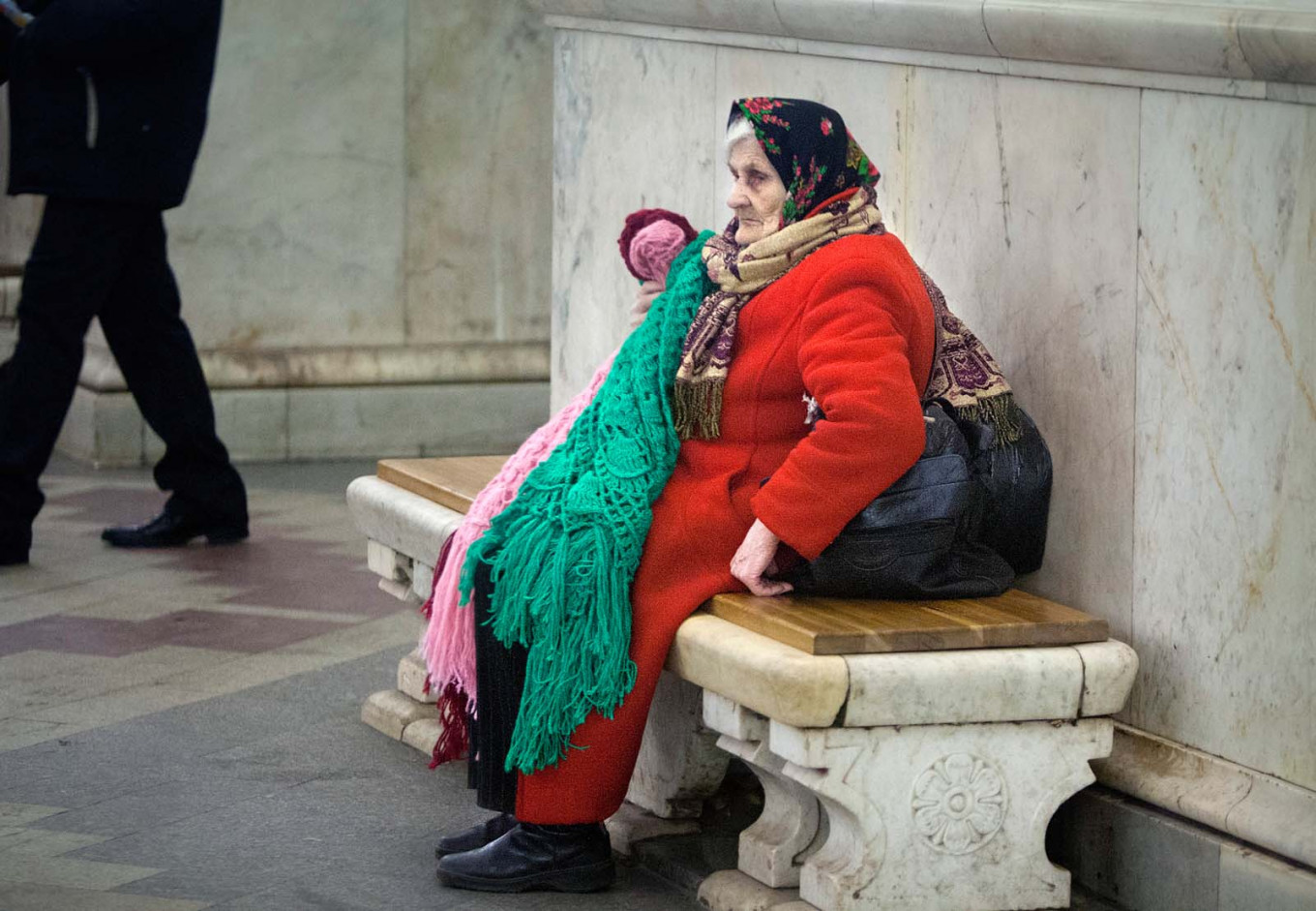 At Kievskaya metro station, a woman selling knitted scarves.				 				Vladimir Filonov / MT