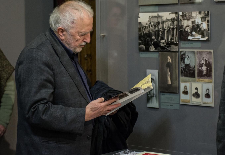 A museum-goer examining a catalog. Tatyana Gord