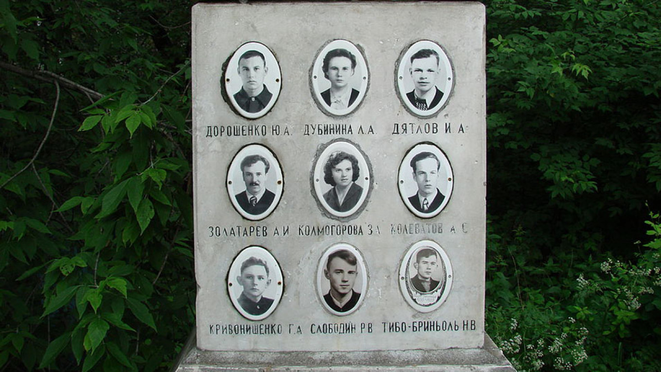 Photos of members of the tour group at their monument. Public Domain