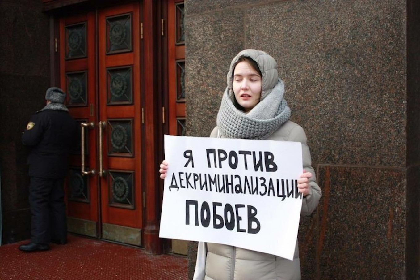 Women's rights activists demonstrated outside State Duma building, hoping lawmakers would reconsider. Elena Plotnikova / TASS