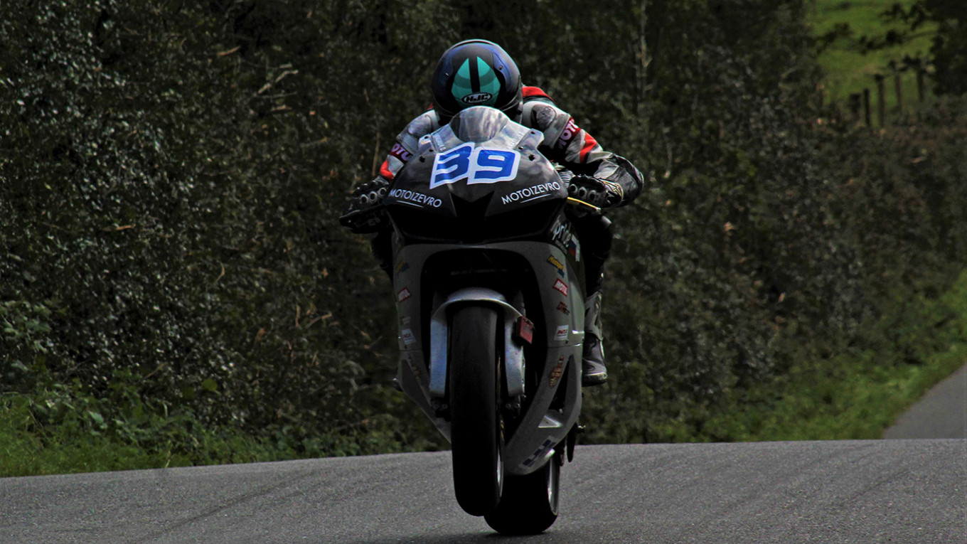 Danila Krasniuk races over the bumps of Cookstown with one wheel pawing the air. Ben McCook / MT