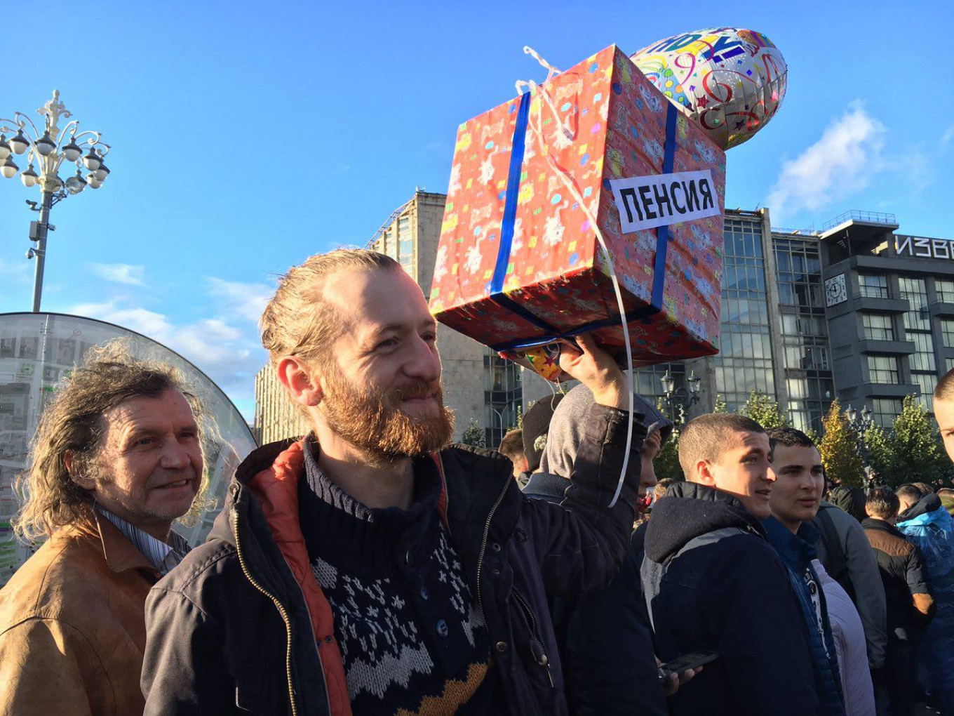 """In Moscow, Yevgeny carries a present labeled """"Retirement,"""" which he has been meaning to give to Putin """"for five years."""" Ksenia Churmanova / For MT"""