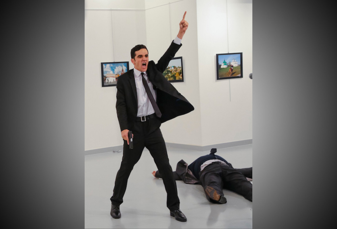 In this Dec. 19, 2016 file photo, Mevlut Mert Altintas shouts after shooting Andrei Karlov at an art gallery in Ankara, Turkey.				 				Burhan Ozbilici / AP