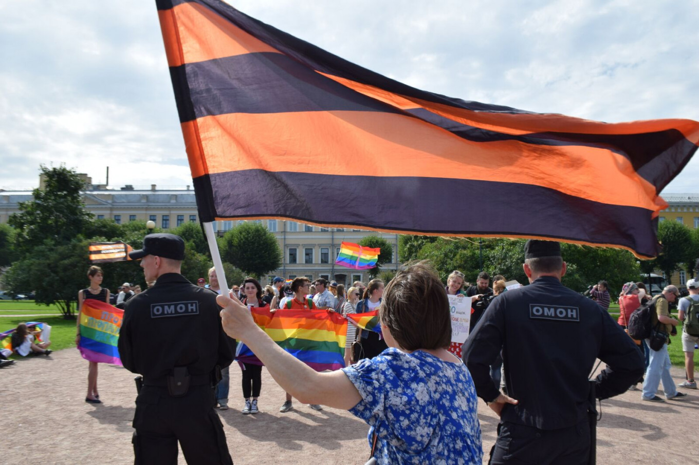 A handful of protesters waved the orange-and-black flag of St. George's, a symbol of Russian patriotism, while condemning the LGBT pride. Francesca Visser and Andreas Rossbach