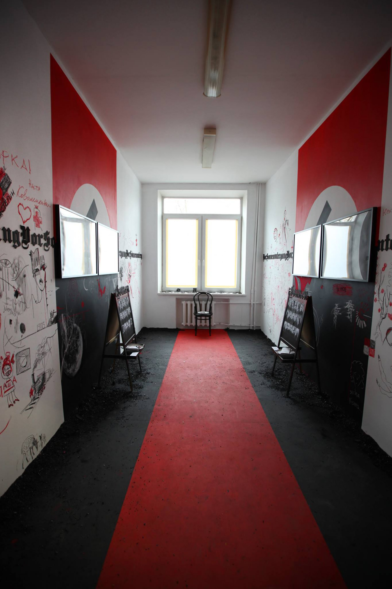 Yury Kharikov transformed his room into a black-and-red pavilion based on the motifs of the play 'Before Sunset.' POLINA BAKHTINA / FACEBOOK
