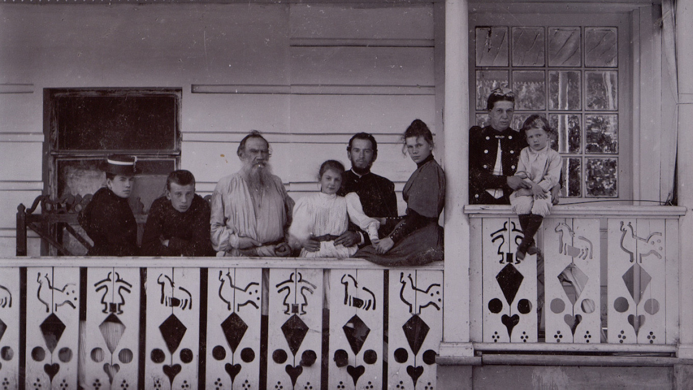 Leo Tolstoy, his wife Sophia Andreyevna and their children on the veranda of the writer's estate.				 				Yasnaya Polyana