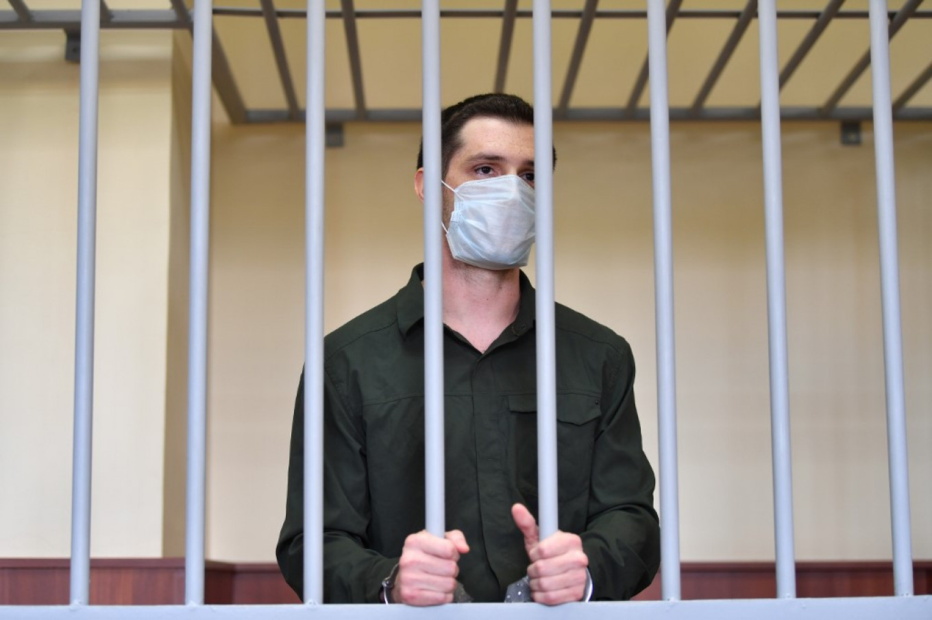 Russian Court Sentences U.S. Ex-Marine to 9 Years for Police Assault