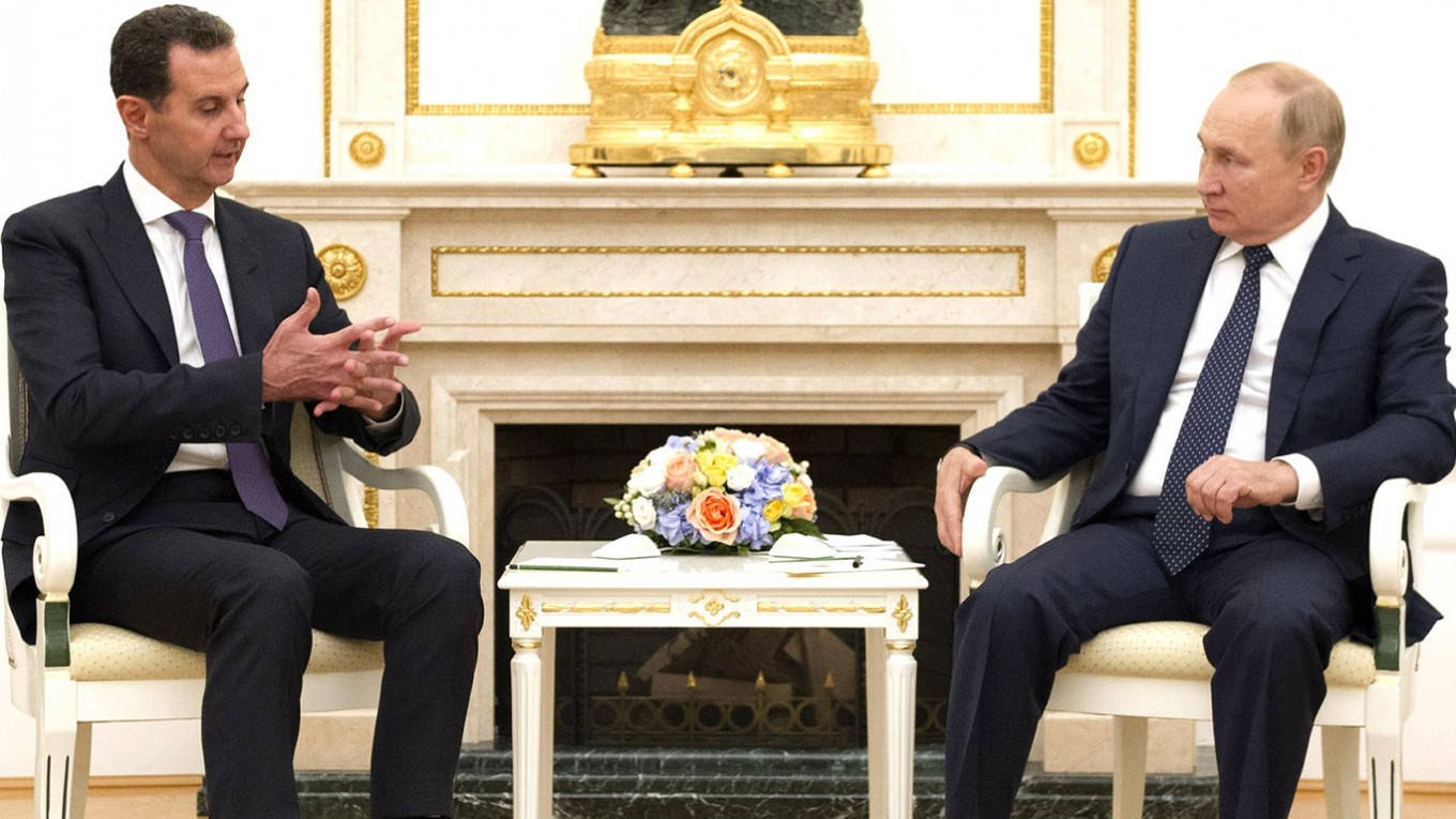 Syria's Assad Meets Putin in Unannounced Russia Visit – The Moscow Times