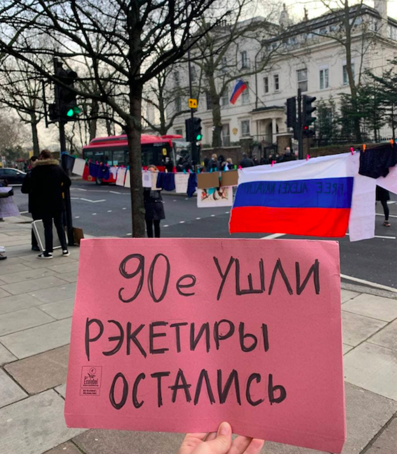 """""""The 90s have gone. The racketeers remain."""" A small group of protesters gathered outside the Russian Embassy in London on Saturday."""