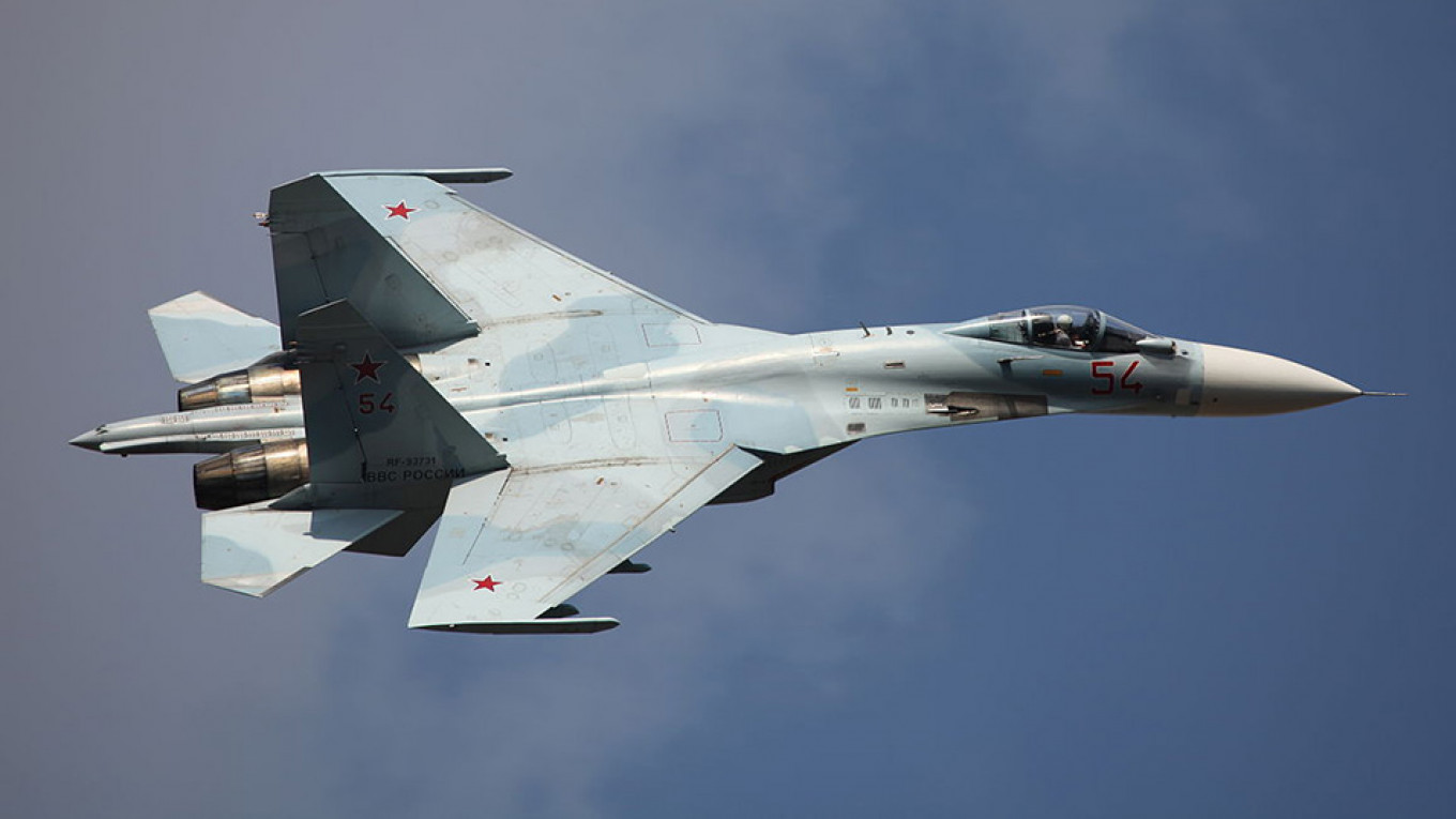 Russian Fighter Jets Push NATO War Plane Away